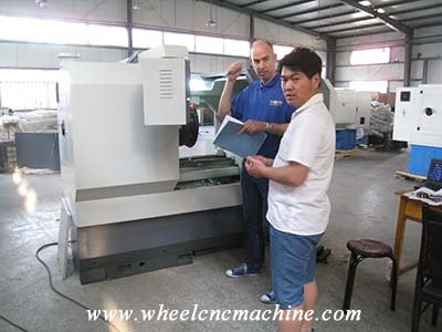 Our partner from England Learned how to operate CNC wheel lathe machine